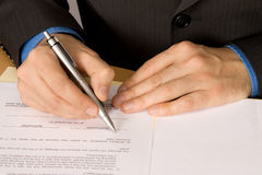 Signing papers. Man signing a business contract Royalty Free Stock Photos