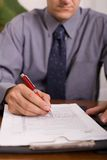 Signing papers Royalty Free Stock Photos