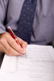 Signing papers. Businessman checking or signing contract papers stock photo