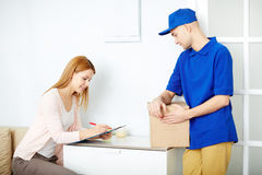 Signing for parcel Royalty Free Stock Photos