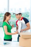 Signing for receiving packages Stock Photography