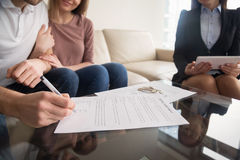 Signing of rental agreement, couple meeting with real estate age Stock Images