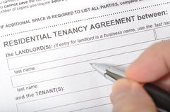 Signing a rental contract. Man signing a rental contract Royalty Free Stock Photos