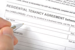 Signing a rental contract Stock Photography
