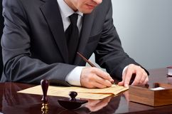 Signing testament. Businessman notarize testament at notary public office royalty free stock photography