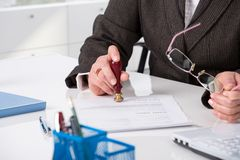Signing testament. Businessman notarize testament at notary public office stock images