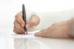 Signing work injury claim Royalty Free Stock Photo