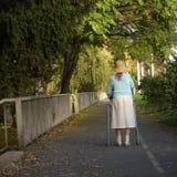 Signora anziana e sola Fotografia Stock