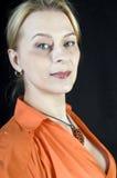 Signora in arancio Fotografia Stock