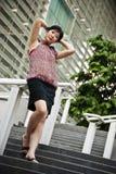 Signora cinese ad all'aperto, PutraJaya, Malesia dell'ufficio Immagini Stock