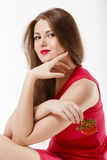 Signora con caramello Fotografia Stock