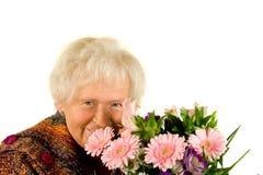 Signora con i fiori Fotografia Stock