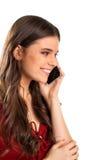 Signora con il telefono sta sorridendo Immagini Stock