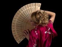 Signora con il ventilatore fotografie stock