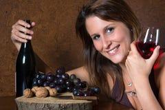 Signora con la bottiglia di vino Immagine Stock