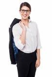 Signora corporativa con la giacca sportiva lanciata sopra la sua spalla Immagine Stock