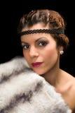 signora degli anni 20 con pelliccia Fotografie Stock