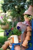 Signora del POT di fiore Immagini Stock