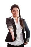 Signora di affari con la sua mano allungata Immagine Stock Libera da Diritti