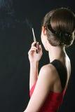 Signora di fumo Fotografia Stock