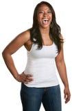 Signora di risata con la mano sull'anca Fotografia Stock