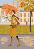 Signora e città di autunno Immagini Stock
