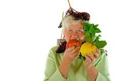 Signora e frutta Fotografie Stock