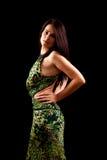 Signora graziosa isolata sul nero Fotografia Stock
