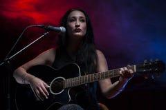 Signora Guitarist fotografia stock
