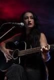 Signora Guitarist immagine stock