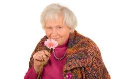 Signora maggiore con il fiore Fotografia Stock