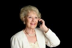 Signora maggiore sul telefono delle cellule Fotografie Stock