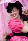 Signora nel colore rosa Fotografia Stock