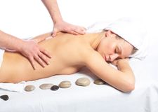 Signora nel salone di massaggio Fotografia Stock