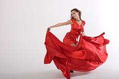Signora sexy ballante nel colore rosso Fotografia Stock Libera da Diritti