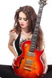 Signora sexy con la chitarra luminosa immagini stock