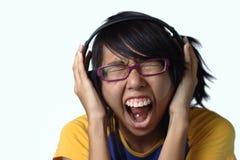 Signora teenager asiatica che grida Immagine Stock