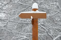 Signpost. Direction signpost in winter snow stock image