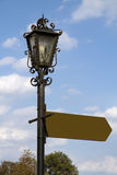Signpost. Street lamp with blank Signpost stock images
