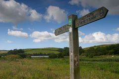 Signpost. A wooden signpost in Devon, UK stock photos