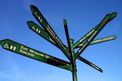 Signpost. Multi-direction signpost against blue sky Stock Photos