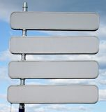 Signpost with 4 blank signs spaces Stock Photography