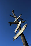 Signpost. The old wooden signpost against the blue sky stock photo