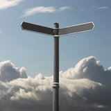 Signpost. A Blank Signpost with Clouds stock photography