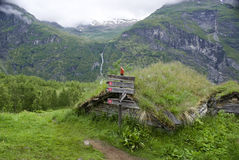 Signpost above Geirangerfjorden. And old hut overgrown by grass. norway Royalty Free Stock Images