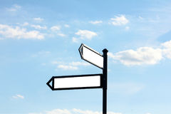 Signpost against the blue sky. Blank area text Stock Image
