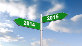 2014 and 2015 signpost against blue sky stock video footage