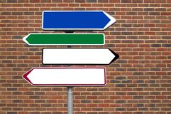 Signpost against a brick wall Stock Photos