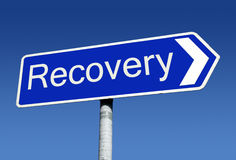 Signpost along the road to recovery. A signpost along the road to recovery Stock Photography