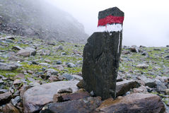 Signpost Alps Austria Fog. A signpost in the tirol alps guiding the way on a hiking trial Royalty Free Stock Image